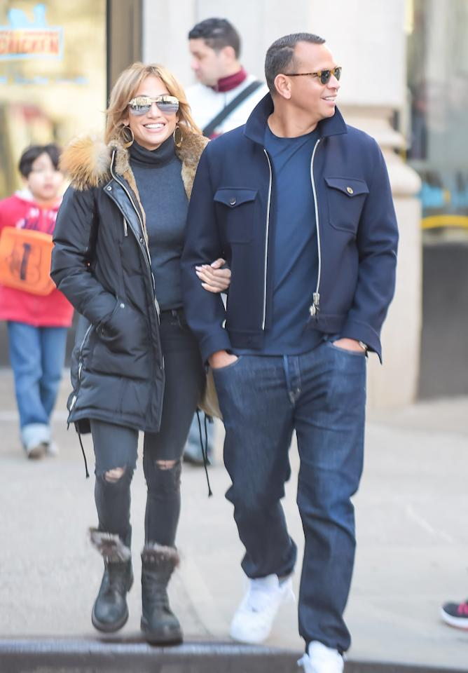 """<p>J.Lo and her new boyfriend, former Yankee Alex Rodriguez, took chilly Manhattan arm-in-arm. The famed triple threat bundled up in a black parka (shop a similar look <a rel=""""nofollow"""" href=""""http://www.anrdoezrs.net/links/7799179/type/dlg/sid/ISJLoSSParkaIJApril/http://www.revolve.com/nicole-benisti-fordham-bomber-down-jacket-with-gold-fox-and-asiatic-rabbit-fur-in-black-golden-fox-fur/dp/NICR-WO8/?"""">here</a>), distressed black skinny jeans, a dark gray turtleneck, fur-lined combat boots, silver aviator shades (shop a similar look <a rel=""""nofollow"""" href=""""https://click.linksynergy.com/fs-bin/click?id=93xLBvPhAeE&subid=0&offerid=484990.1&type=10&tmpid=23604&RD_PARM1=https%253A%252F%252Fwww.shopbop.com%252Fplaya-sunglasses-quay%252Fvp%252Fv%253D1%252F1518230472.htm%253FfolderID%253D2534374302024641%2526fm%253Dother-shopbysize-viewall%2526os%253Dfalse%2526colorId%253D18270%2526extid%253Daffprg_linkshare_SB-%252A2nGiS3mv0Y%2526cvosrc%253Daffiliate.linkshare.%252A2nGiS3mv0Y&u1=ISJLoSSAviatorsIJApril"""">here</a>), and her trademark gold hoops (shop a similar look <a rel=""""nofollow"""" href=""""https://click.linksynergy.com/fs-bin/click?id=93xLBvPhAeE&subid=0&offerid=483151.1&type=10&tmpid=5462&RD_PARM1=http%253A%252F%252Fwww.neimanmarcus.com%252FLana-2423-LG-GLOSS-HOOPS%252Fprod198560588%252Fp.prod%253F&LSNSUBSITE=LSNSUBSITE&u1=ISJLoSSGoldHoopsIJApril"""">here</a>), while A-Rod opted for slouchy denim, a navy jacket, and white sneakers. </p>"""