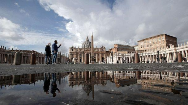 PHOTO: \In this Sunday, Jan. 31, 2021 file photo, people are reflected on a puddle as they walk in St. Peter's Square, at the Vatican. (Alessandra Tarantino/AP, FILE)