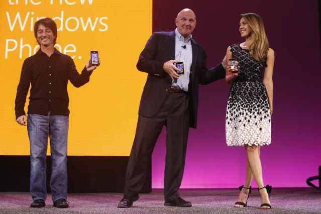 SAN FRANCISCO - OCTOBER 29: (L to r) Microsoft Corporate Vice President Joe Delfiore, CEO Steve Ballmer and actress Jessica Alba hold a smartphone featuring Windows Phone 8 during a product launch at Bill Graham Civic Auditorium on October 29, 2012 in San Francisco, California. The Windows Phone 8 marks the Seattle-based company's latest update from its two-year-old Windows Phone 7 platform as the company looks to regain its traction in the increasingly dense smartphone segment dominated by rivals Apple and Google. (Photo by Stephen Lam/Getty Images)