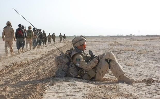 Former Cpl. John Lowe rests during an operation on March 23, 2010 in Panjwaii, Afghanistan. (Murray Brewster/Canadian Press - image credit)