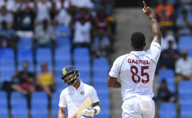 Shannon Gabriel (L) of West Indies celebrates the dismissal of Virat Kohli (L) of India during day 1 of the 1st Test between West Indies and India at Vivian Richards Cricket Stadium in North Sound, Antigua and Barbuda, on August 22, 2019. (Photo by Randy Brooks / AFP)