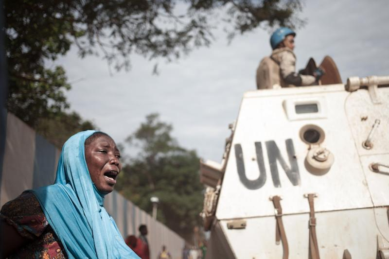 A woman weeps near a UN armoured vehicle outside Minusca headquarters during a demonstration in April by people from a flashpoint Muslim district who accused UN troops of killing civilians. (AFP Photo/FLORENT VERGNES)