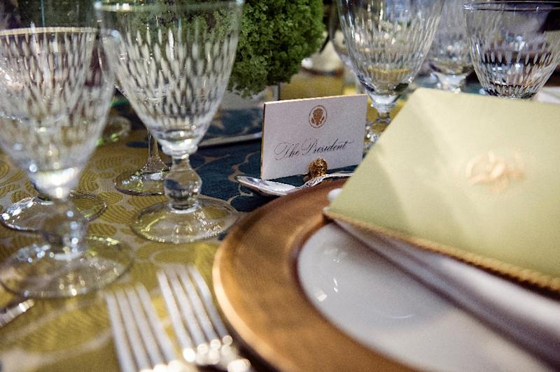 A place setting for US President Barack Obama is seen during a preview before the State Dinner for Canadian Prime Minister Justin Trudeau at the White House March 9, 2016 (AFP Photo/Brendan Smialowski)