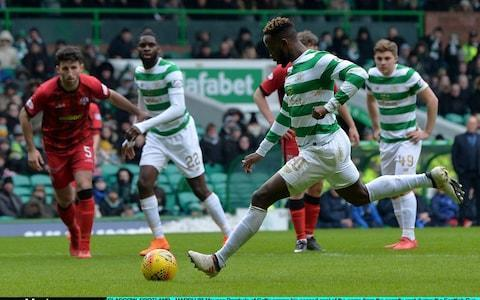 "Celtic kept on course for a second successive domestic treble when they disposed of Greenock Morton in the quarter-finals of the William Hill Scottish Cup with what proved to be an ultimately comfortable victory, despite a goalless first half. The holders enjoyed 70% of possession in the first half but could not find a way through an obdurate Morton midfield and back line, marshalled by the vastly experienced Gary Harkins. By the hour mark of the lunchtime fixture some Celtic fans had begun to speculate on the possibility of a replay but their anxiety was soothed when Moussa Dembele met a fine cross from Tom Rogic with a header which Derek Gaston reached, but could not stop. Dembele added a second from the penalty spot soon afterwards, having gone down in a challenge from Michael Doyle, although the initial contact occurred outside the box. Odsonne Edouard, who had replaced Scott Sinclair at half time, struck Celtic's third in the dying seconds and – despite having missed two simple chances while the score was still 0-0 – was praised by Brendan Rodgers. ""Odsonne was the key difference in the game,"" said the Hoops manager. ""He shows his quality, his hold-up play, his movement, his speed, then scores a very good goal."" The second tie of the afternoon, between Aberdeen and Kilmarnock, went ahead at Pittodrie although the South Stand was closed because its water supply had been disrupted. Kilmarnock have been the surprise package of the Scottish Premiership since Steve Clarke took over in the autumn, but their record against Aberdeen is less impressive and includes two 3-1 defeats. Moussa Dembele opened the scoring for the hosts with two goals in nine minutes Credit: Getty Images The Dons seemed to be heading towards another victory when they went ahead in the first half after their captain, Graeme Shinnie, saw an attempted cross veer into the net. That advantage was, however, annulled when Shay Logan and Kari Arnason were judged to have fouled Jordan Jones for a penalty kick which was put away by the veteran Killie striker, Kris Boyd, for his 17th goal of the season, to ensure a replay at Rugby Park on March 13. Speaking to BBC Scotland afterwards, the Aberdeen manager, Derek McInnes, disputed the award that led to the equaliser when he said: ""I don't think it's a penalty. There isn't any contact, he (Jones) goes down and I can understand maybe why, at first, he thought it could have been a penalty but I don't think my players bring Jones down. ""We got off to a brilliant start and Shinnie's driving runs from full-back were a key part of that in the first half. We were the better team in the first half, we had the better of the opportunities and we played the game more in their half of the field. Meanwhile, ahead of today's meeting of Rangers and Falkirk, Graeme Murty admitted that he remains taken aback that he is in charge at Ibrox, even four months into a second interim spell in the position. Talk of a title challenge to Celtic owes more to fanciful imaginations than sober reality, but a second-place finish and a single-figure points gap would represent progress to the Rangers faithful and advance Murty's prospect of a longer spell as manager. ""I'm still stunned to be sitting here, to be perfectly honest,"" Murty said. ""I'm enjoying every moment and I am still thankful and grateful for the opportunity. Graeme Murty is in his second spell as Rangers interim manager Credit: PA ""Whether it continues will always be outwith the people in this group and it won't be down to me, but what we can do is make sure the players put themselves in a really good situation to be successful in the latter part of the season. And if we do that, you never know what might happen. It might all have a positive outcome."" Should Rangers beat Falkirk, Murty will reacquaint himself with Hampden Park. He never played there during his four appearances for Scotland but Murty savoured a visit to the stadium when Rangers beat Ronny Deila's Celtic in a Scottish Cup semi-final in 2016. ""I love it. It's fantastic,"" he said. ""My first experience as a Rangers employee of an Old Firm game was going there and watching it and the players will tell you that they're desperate to get there. But we have to take care of the next game and when we actually walk out at Ibrox, that game at Hampden won't be on our minds. ""It'll be making sure that we take care of business and perform properly and – credit to the players – they've done that remarkably well since Christmas and moved their own game forward, fairly significantly, I would say."" Motherwell are at home to Hearts earlier this afternoon in the other quarter-final tie and the draw for the semi-finals will be made at Ibrox after the Rangers v Falkirk match."