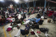 Migrants who were part of a caravan heading north stop to rest in Huixtla, Chiapas state, Mexico, Sunday, Sept. 5, 2021. (AP Photo/Marco Ugarte)