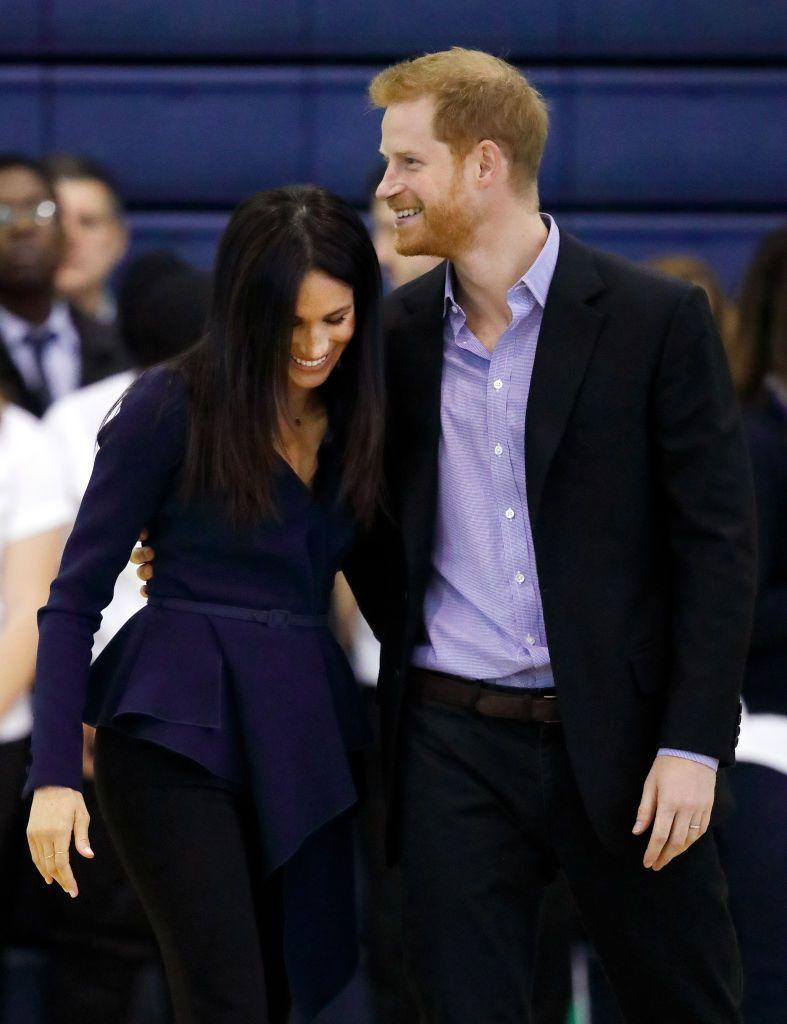 <p>And here's Meghan hitting Harry with some side-hug action during a royal engagement in September 2018. Seriously, can you image Will and Kate doing this? </p>