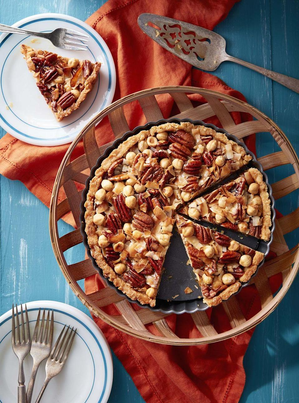 "<p>2020 has been nuts. Send off the old year with this extra-nutty tart.</p><p><strong><a href=""https://www.countryliving.com/food-drinks/a34275342/pecan-hazelnut-coconut-tart/"" rel=""nofollow noopener"" target=""_blank"" data-ylk=""slk:Get the recipe"" class=""link rapid-noclick-resp"">Get the recipe</a>.</strong></p><p><a class=""link rapid-noclick-resp"" href=""https://www.amazon.com/Fox-Run-44513-Bottom-Quiche/dp/B000QIZ1I2/?tag=syn-yahoo-20&ascsubtag=%5Bartid%7C10050.g.1078%5Bsrc%7Cyahoo-us"" rel=""nofollow noopener"" target=""_blank"" data-ylk=""slk:SHOP TART PANS"">SHOP TART PANS</a><br></p>"