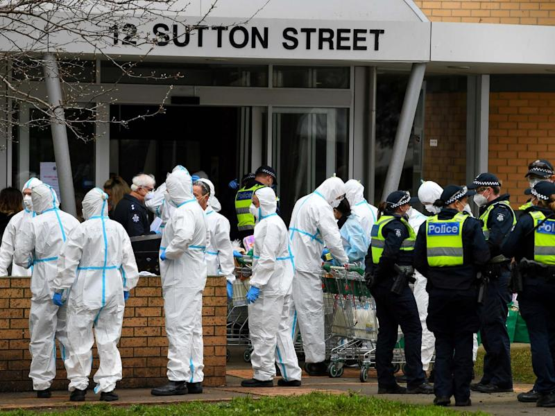 Firefighters prepare to distribute food throughout a Melbourne public housing tower, locked down in response to an outbreak of coronavirus: REUTERS