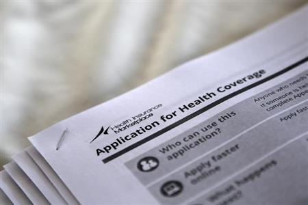 """The federal government forms for applying for health coverage are seen at a rally held by supporters of the Affordable Care Act, widely referred to as """"Obamacare"""", outside the Jackson-Hinds Comprehensive Health Center in Jackson, Mississippi October 4, 2013. REUTERS/Jonathan Bachman"""