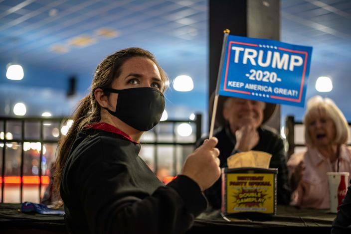 An attendee at a watch party for Republicans waves a Trump 2020 flag on election day, November 3, 2020 in Austin, Texas. (Sergio Flores/AFP via Getty Images)