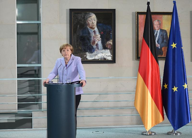 German Chancellor Angela Merkel addresses members of the diplomatic corps at the chancellery in Berlin on July 13, 2015 (AFP Photo/Britta Pedersen)