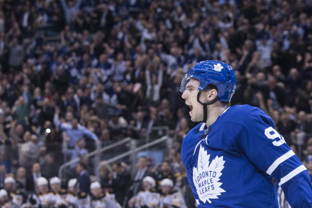 Toronto Maple Leafs' Igor Ozhiganov celebrates after scoring his first goal in the NHL during second-period NHL hockey game action against the Boston Bruins in Toronto, Monday, Nov. 26, 2018. (Chris Young/The Canadian Press via AP)