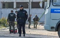 Russian investigators examined the college in Kerch, Crimea where a student opened fire