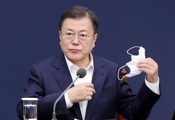 <p>President Moon Jae-in during a meeting with his senior secretaries at the presidential office Cheong Wa Dae in Seoul</p> (EPA)