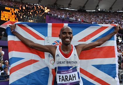 Mohamed Farah holds a union jack as he celebrates winning gold in the Men's 5000m Final (Getty Images)
