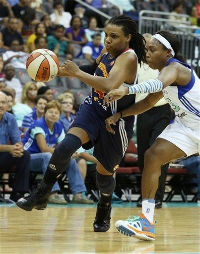 Connecticut Sun guard Tan White, left, dribbles past Connecticut Sun guard Allison Hightower, right, during a WNBA basketball game at the Prudential Center, Thursday, Aug.16, 2012, in Newark, N.J. (AP Photo/John Minchillo)