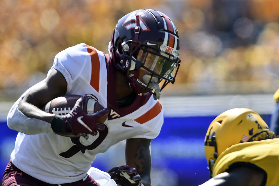 Virginia Tech wide receiver Tayvion Robinson (9) is tackled by West Virginia safety Alonzo Addae (4) during the first half of an NCAA college football game in Morgantown, W.Va., Saturday, Sept. 18, 2021. (AP Photo/William Wotring)