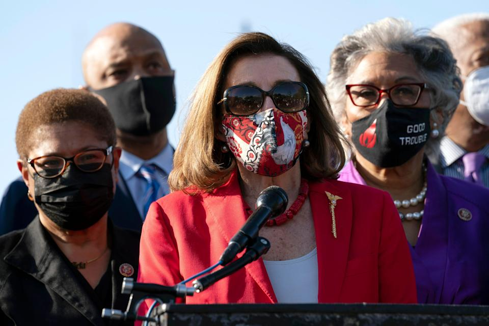 House Speaker Nancy Pelosi speaks about George Floyd as chairwoman of the Congressional Black Caucus, Rep. Joyce Beatty, D-Ohio, right, and other members of the Congressional Black Caucus listen, on Capitol Hill  April 20, 2021, after the jury convicted former Minneapolis police officer Derek Chauvin.