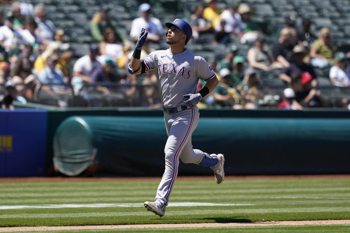 Texas Rangers' Joey Gallo gestures after hitting a two-run home run against the Oakland Athletics during the seventh inning of a baseball game in Oakland, Calif., Thursday, July 1, 2021. (AP Photo/Jeff Chiu)