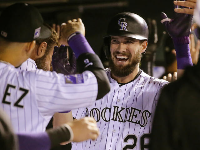 David Dahl and the Rockies have taken over the NL's second Wild Card spot. (AP)
