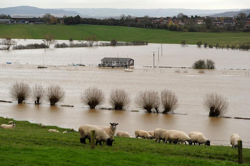 A property stands surrounded by floodwater near the the River Severn in Tewkesbury, England, Tuesday Nov. 27, 2012. Thousands of drivers and residents face further chaos today after heavy rain continued to fall across Britain overnight. (AP Photo/PA, Tim Ireland) UNITED KINGDOM OUT NO SALES NO ARCHIVE