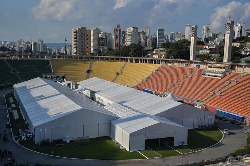 View of a temporary field hospital set up for coronavirus patients at Pacaembu stadium, in Sao Paulo, Brazil on March 27, 2020. - Brazil's top football clubs are handing over their stadiums to allow health authorities to turn them into field hospitals and clinics to fight the coronavirus pandemic. (Photo by NELSON ALMEIDA / AFP) (Photo by NELSON ALMEIDA/AFP via Getty Images)