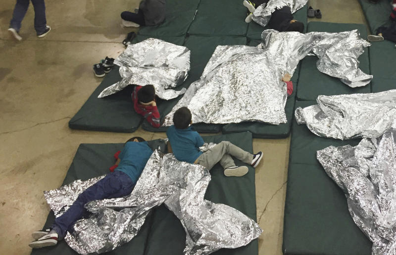 FILE - In this Sunday, June 17, 2018, file photo provided by U.S. Customs and Border Protection, people who've been taken into custody related to cases of illegal entry into the United States rest in one of the cages at a facility in McAllen, Texas. Immigrant children described hunger, cold and fear in a voluminous court filing about the facilities where they were held in the days after crossing the border. Advocates fanned out across the southwest to interview more than 200 immigrant parents and children about conditions in U.S. holding facilities, detention centers and a youth shelter. The accounts form part of a case over whether the government is complying with a longstanding settlement over the treatment of immigrant youth in custody. (U.S. Customs and Border Protection's Rio Grande Valley Sector via AP, File)