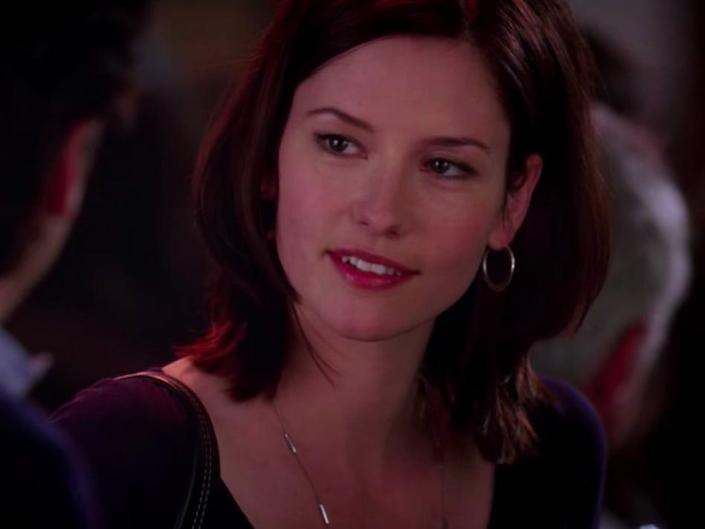 Chyler Leigh as Lexi on Greys Anatomy wearing a dark colored shirt and necklace