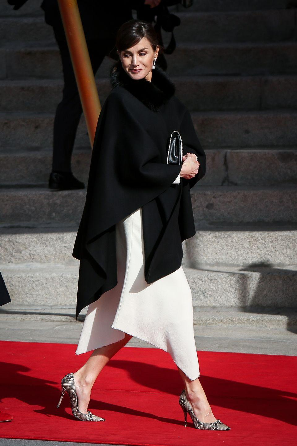 <p>While attending the Spanish Parliament, Queen Letizia looked chic in a black shawl, white skirt, and snakeskin pumps. </p>