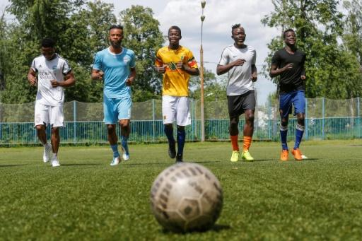 Players of the Black Stars, a team created for African footballers, train at a pitch in the Moscow suburbs