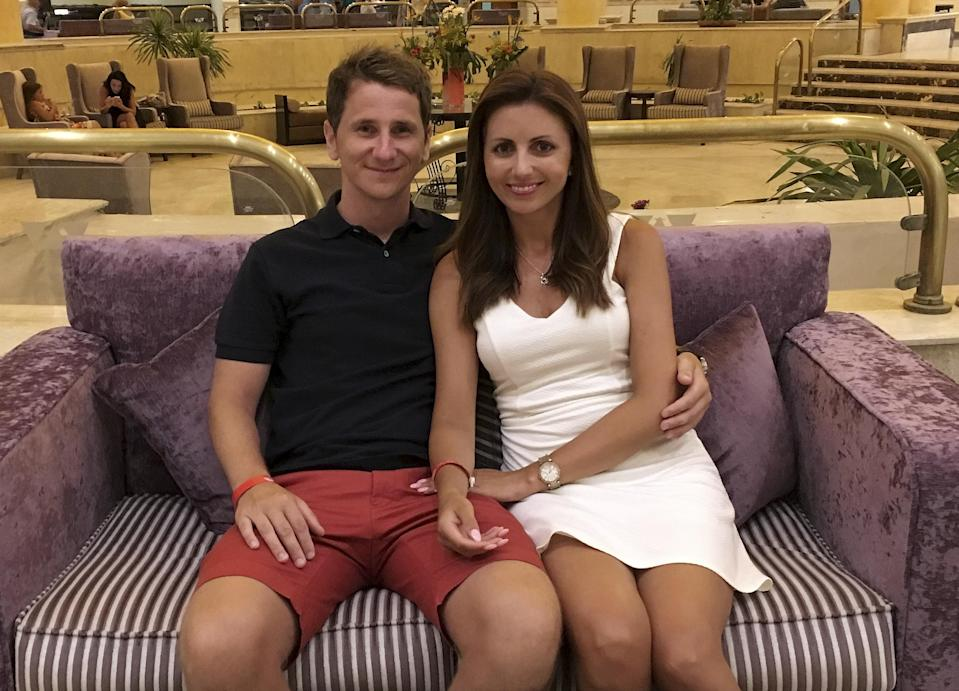 Arron Coles, with partner Jana, arrived back from holiday to a £2,600 bill (SWNS.com)