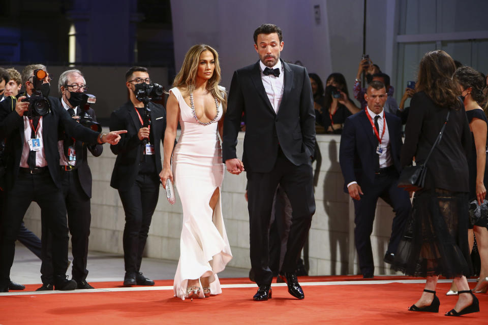 """Jennifer Lopez and Ben Affleck pose for photographers upon arrival at the premiere of the film """"The Last Duel"""" during the 78th edition of the Venice Film Festival in Venice on Sept. 10, 2021. - Credit: Joel C Ryan/Invision/AP"""
