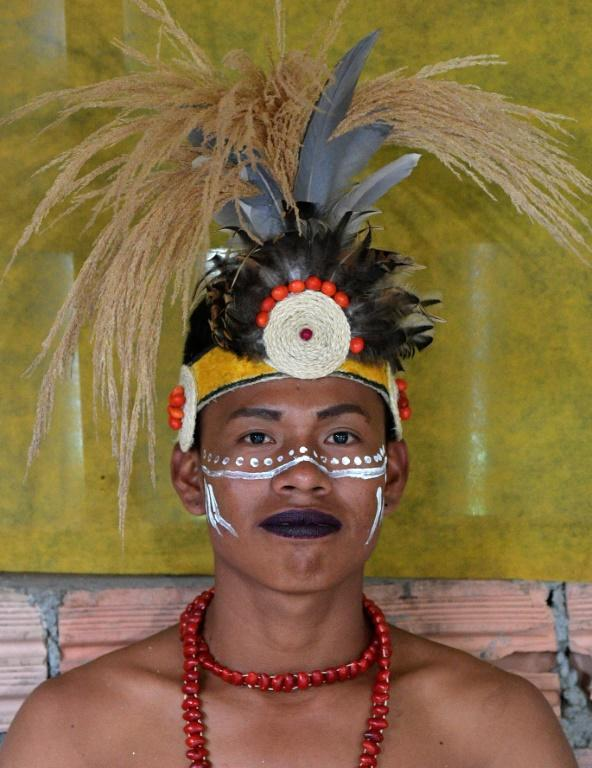 A gay indigenous man poses for a picture in the community of Nazareth