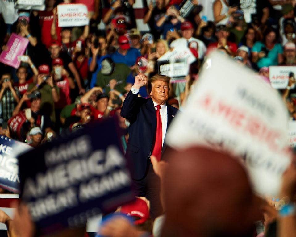 President Donald Trump gestures during a campaign rally in Sanford, Florida, U.S., on Monday, Oct. 12, 2020. (Photographer: Zack Wittman/Bloomberg)