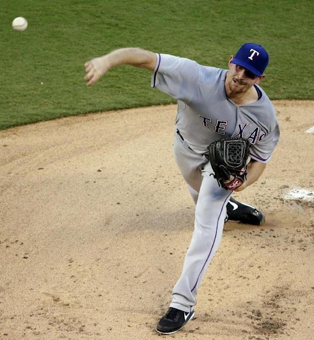 Texas Rangers starting pitcher Nick Tepesch throws during the first inning of a baseball game against the Kansas City Royals, Wednesday, Sept. 3, 2014, in Kansas City, Mo. (AP Photo/Charlie Riedel)
