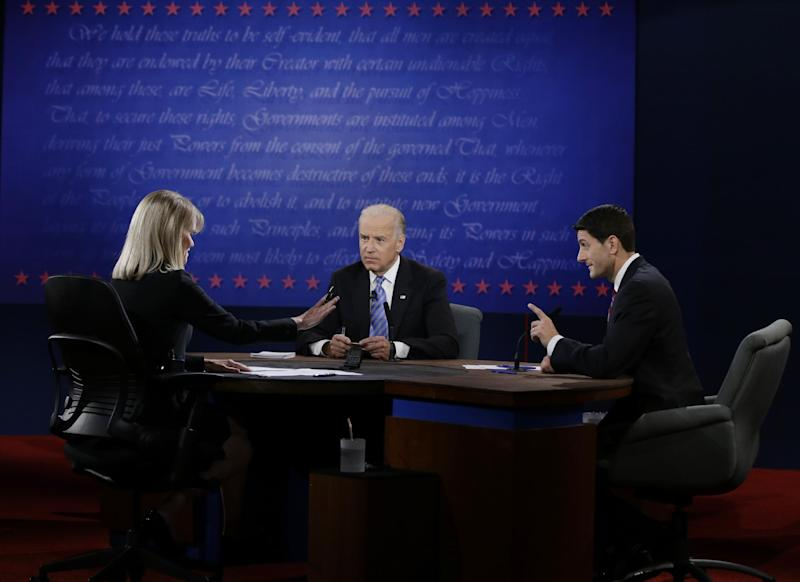 Republican vice presidential nominee Rep. Paul Ryan, of Wisconsin, right, and Vice President Joe Biden, center, listen to moderator Martha Raddatz during the vice presidential debate at Centre College, Thursday, Oct. 11, 2012, in Danville, Ky. (AP Photo/David Goldman)