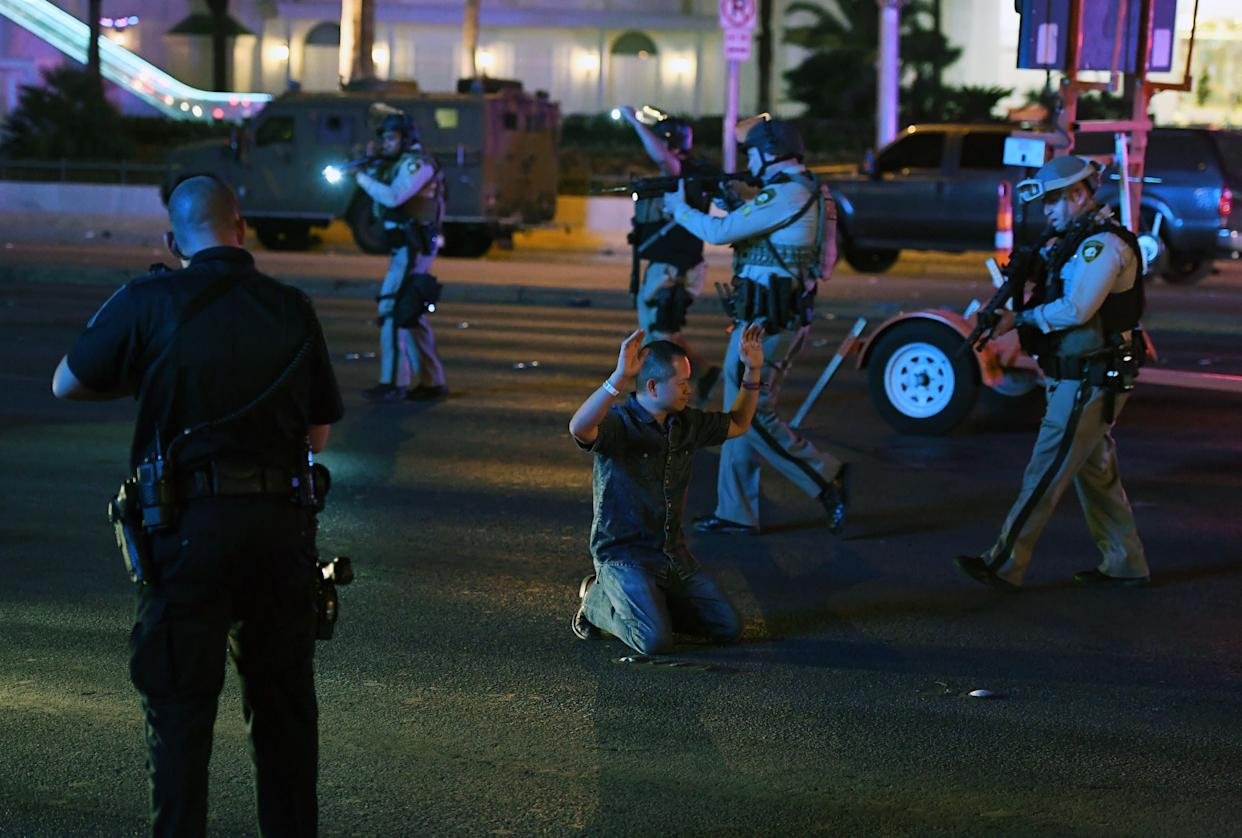 Police officers stop a man who drove down Tropicana Avenue near Las Vegas Boulevard, which had been closed.