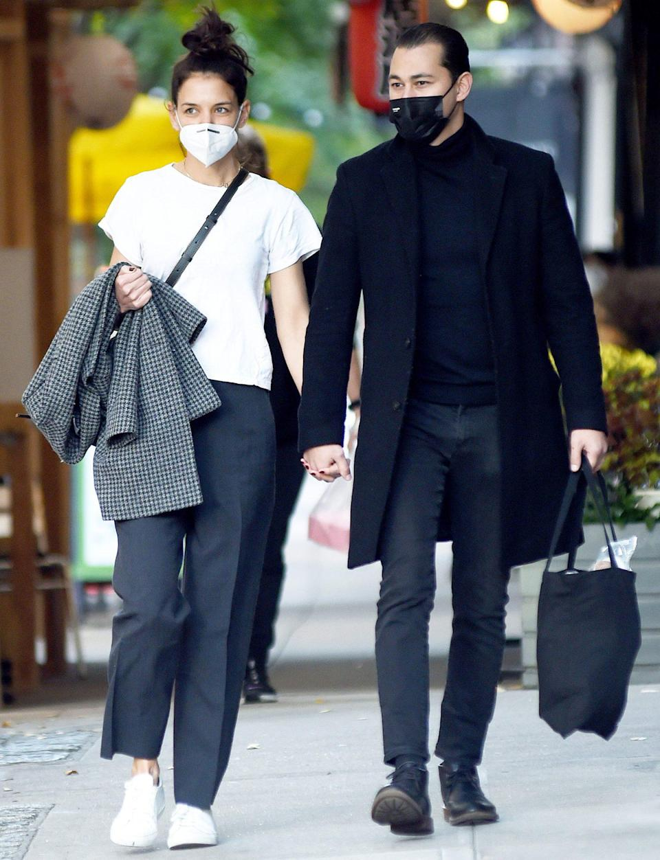 <p>Katie Holmes and boyfriend Emilio Vitolo Jr. enjoy the fall weather in N.Y.C. on Monday. </p>