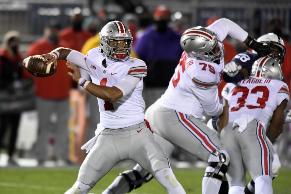 Ohio State quarterback Justin Fields (1) looks for a receiver during the first quarter against Penn State in an NCAA college football game in State College, Pa., Saturday, Oct. 31, 2020. (AP Photo/Barry Reeger)