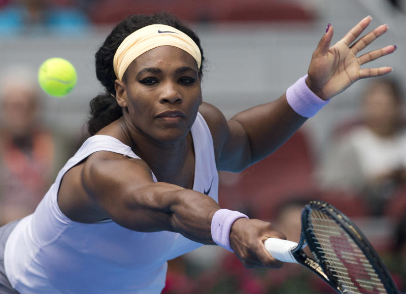 Serena Williams of U.S. returns a shot to Maria Kirilenko of Russia during the China Open tennis tournament at the National Tennis Stadium in Beijing, China Thursday, Oct. 3, 2013. (AP Photo/Andy Wong)