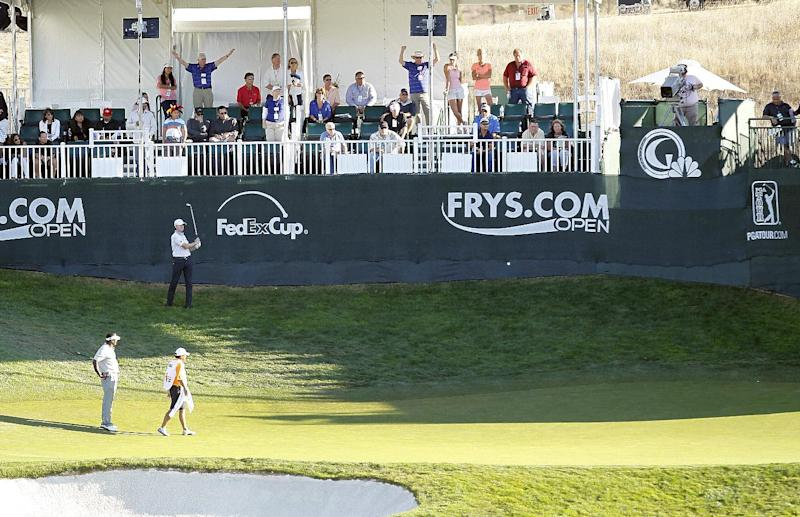 Jimmy Walker, top, hits onto the 17th green as Vijay Singh, lower left, of Fiji Islands, looks on during the final round of the Frys.com Open golf tournament, Sunday, Oct. 13, 2013, in San Martin, Calif. (AP Photo/Tony Avelar)