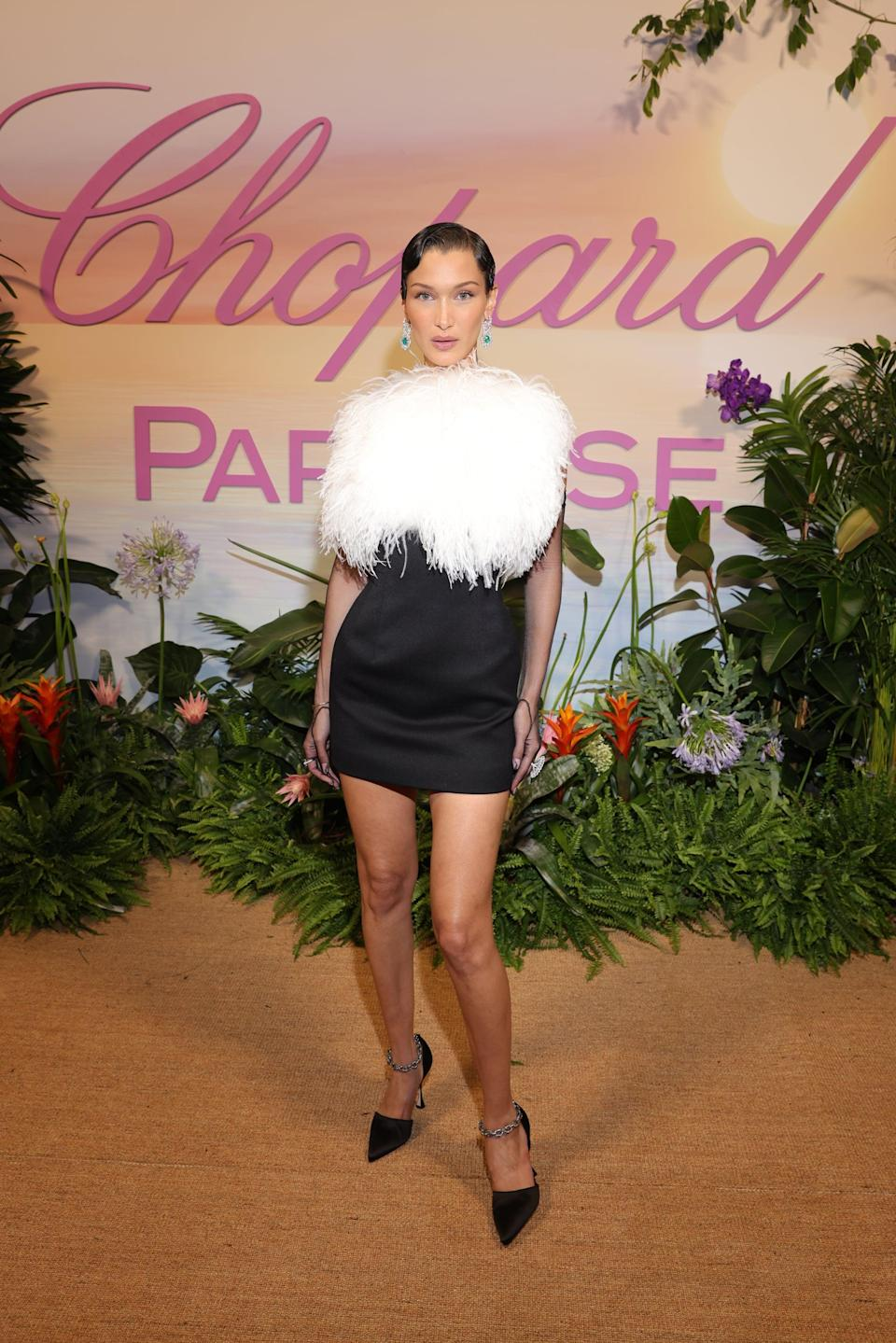 <p>Wearing a fuzzy Lanvin dress with Chopard jewels.</p>