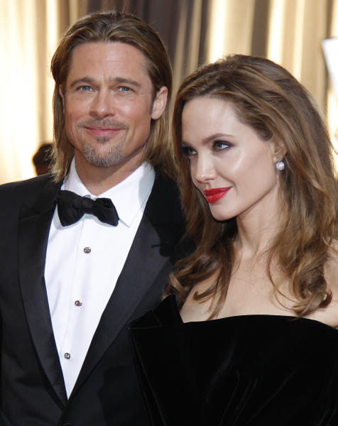 "FILE - This Feb. 26, 2012 file photo shows actors Brad Pitt, left, and Angelina Jolie at the 84th Academy Awards in the Hollywood section of Los Angeles. Pitt says it was important for his partner, Angelina Jolie, to share her story about having her breasts removed to avoid cancer ""and that others would understand it doesn't have to be a scary thing."" In an interview in USA Today on wednesday, May 15, 2013, the actor said: ""In fact, it can be an empowering thing, and something that makes you stronger and makes us stronger."" (AP Photo/Amy Sancetta, file)"
