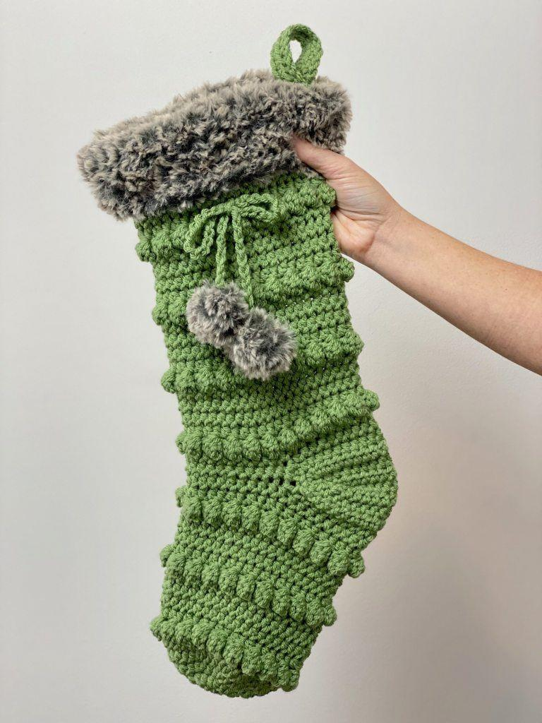 """<p>This stocking looks so warm, we wish we could wear it! Use your favorite colors for these stockings, and don't forget the fluffy pom-poms.</p><p><strong>Get the tutorial at <a href=""""https://www.acraftyconcept.com/crafty-boho-stocking/"""" rel=""""nofollow noopener"""" target=""""_blank"""" data-ylk=""""slk:A Crafty Concept"""" class=""""link rapid-noclick-resp"""">A Crafty Concept</a>.</strong></p><p><strong><a class=""""link rapid-noclick-resp"""" href=""""https://www.amazon.com/Clover-3672-Amour-Crochet-sizes/dp/B00B2CCA6W/ref=sr_1_3?tag=syn-yahoo-20&ascsubtag=%5Bartid%7C10050.g.28872655%5Bsrc%7Cyahoo-us"""" rel=""""nofollow noopener"""" target=""""_blank"""" data-ylk=""""slk:SHOP CROCHET HOOKS"""">SHOP CROCHET HOOKS</a><br></strong></p>"""