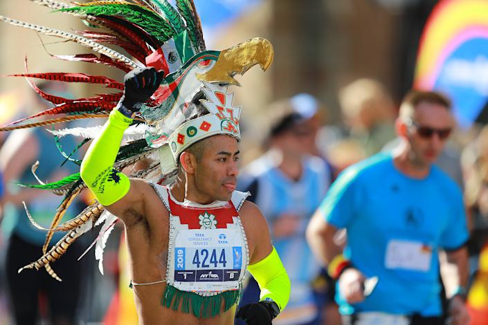 A runner in costume makes his way north on First Avenue during the 2019 TCS New York City Marathon, Nov. 3, 2019 in New York City. (Photo: Gordon Donovan/Yahoo News)