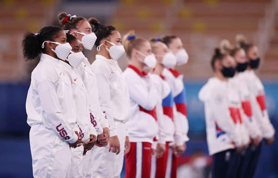 TOKYO, Japan - July 27: Jordan Silis, Simon Piles, Grace McCullum and Team USA's Sunisa Lee respond on stage after winning the silver medal during the women's team final on the fourth day of the Tokyo 2020 Olympics.  Ariac Gymnastics Center on July 27, 2021 in Tokyo, Japan.  (Photo by Ezra Shah / Getty Images)