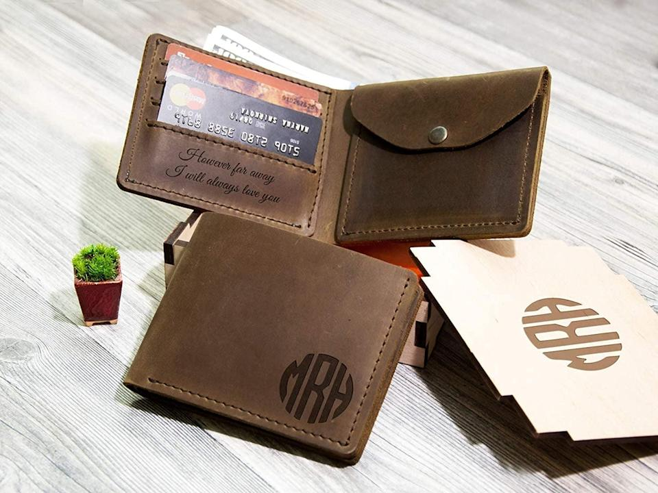 <p>Replace their old, worn out wallet with this <span>Personalized Leather Wallet </span> ($42). It comes in brown, black, whiskey, and walnut, plus your choice of personalization. It can be customized to include a coin pocket as well!</p>