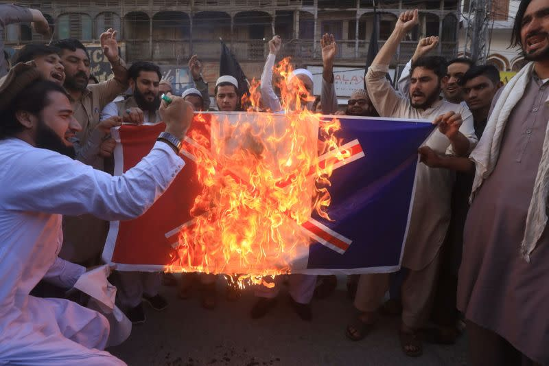 People protest against the publications of the cartoon of Prophet Mohammad in France and comments by the French President Emmanuel Macron, in Peshawar