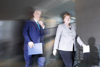 FILE - In this Monday, Feb. 10, 2020 file photo German Chancellor Angela Merkel, right, and Hungary's Prime Minister Victor Orban, left, arrive for a statement prior to a meeting at the chancellery in Berlin, Germany. (AP Photo/Markus Schreiber, File)