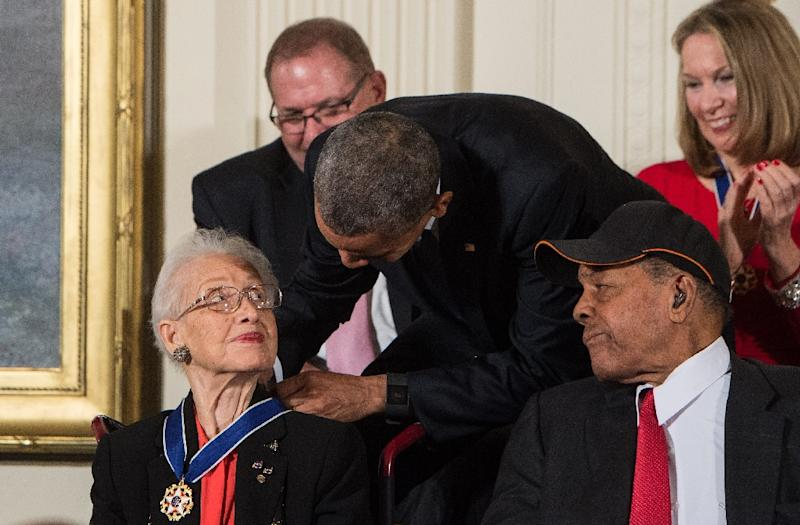 Katherine Johnson, seen here receiving the Presidential Medal of Freedom from Barack Obama, provided pivotal contributions to American space flight research alongside Dorothy Vaughan and Mary Jackson (AFP Photo/NICHOLAS KAMM)